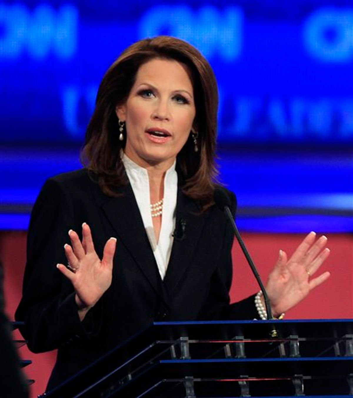 Rep. Michele Bachmann, R-Minn., answers a question during the first New Hampshire Republican presidential debate at St. Anselm College in Manchester, N.H., Monday, June 13, 2011. (AP Photo/Jim Cole) (AP)