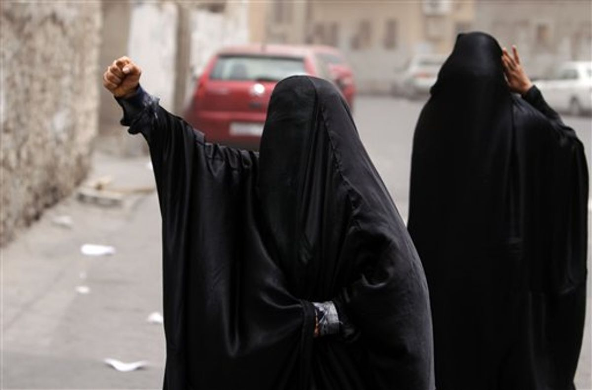 """FILE - In this Friday, June 3, 2011 file photo, Bahraini women shout """"God is greater"""" in the streets of the Shiite Muslim neighborhood of Sanabis in Manama, Bahrain, shortly after riot police dispersed anti-government protesters who began a march after the funeral of a woman they claim died of tear gas inhalation the day before. The Shiite groups that speak on behalf of protesters, who took to the streets four months ago to demand greater rights, have shown no rush to embrace the appeals for dialogue by the Sunni monarchs they accuse of creating a two-tier society in the strategic Gulf kingdom. (AP Photo/Hasan Jamali, File) (AP)"""