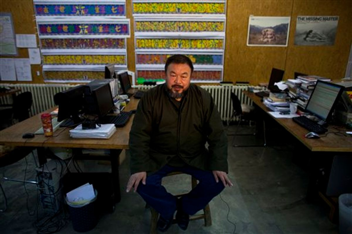 In this Jan. 21, 2010 photo, artist Ai Weiwei speaks during an interview at his studio in Beijing, China.  Chinese state media say renowned activist artist Ai Weiwei has been released on bail after confessing to tax evasion. The Xinhua News Agency says Ai's poor health was also a factor in his release Wednesday, June 22, 2011. (AP Photo/Alexander F. Yuan) (AP)