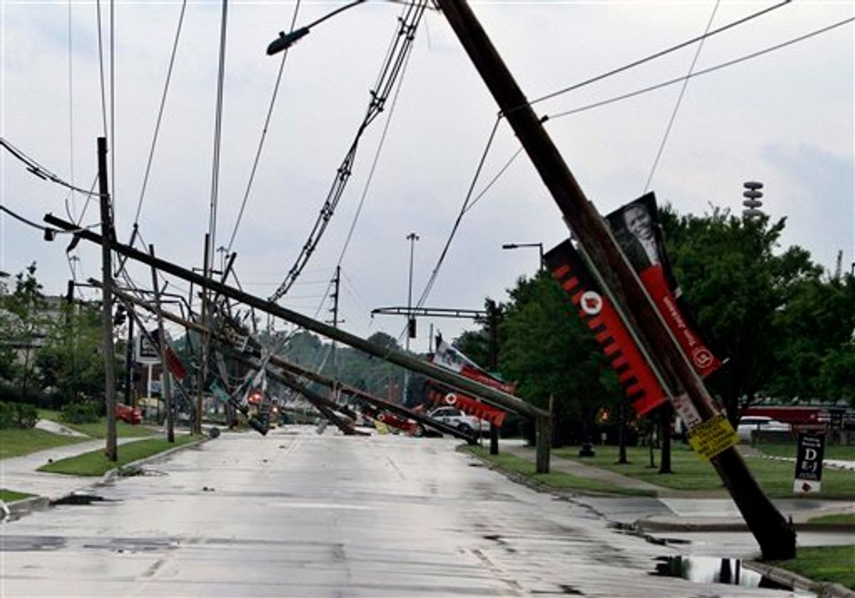 A row of electric power poles snapped along Floyd Street at Central Avenue in front of Cardinal Stadium at the University of Louisville in Louisville, Ky., Wednesday, June 22, 2011 after an apparent tornado moved through the area. At least five barns were damaged and horses were running loose Wednesday at Churchill Downs, home of the Kentucky Derby, after a powerful storm that spawned tornadoes blew through Louisville. (AP Photo/Garry Jones) (AP)