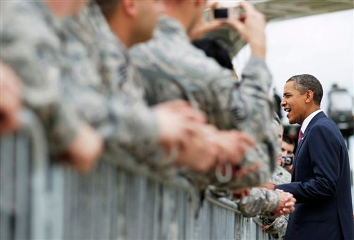 President Barack Obama greets members of the military before boarding Air Force One at the 171st Air Refueling Wing of the Pennsylvania Air National Guard Base in Coraopolis, Pa., Friday, June 24, 2011. (AP Photo/Carolyn Kaster) (AP)