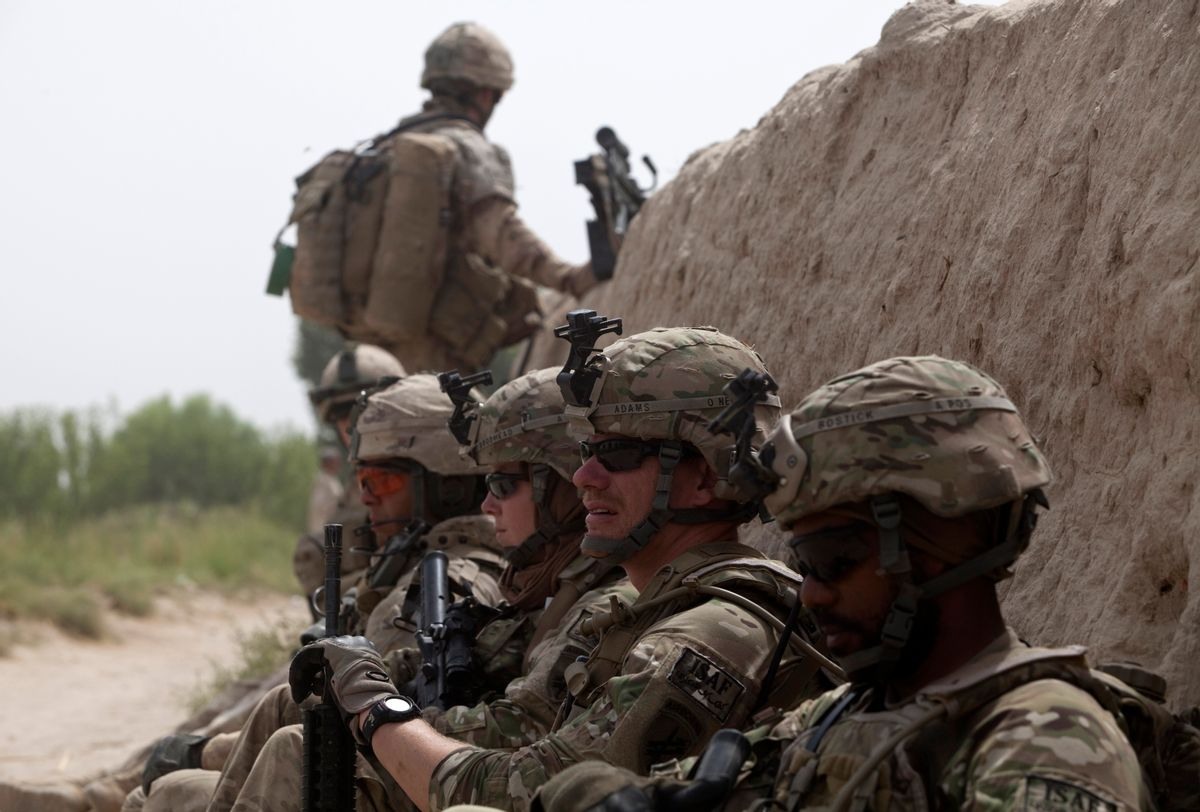 Canadian and U.S. army soldiers attached to 1st Battalion, 22nd royal regiment rest during a patrol in the Panjwai district of Kandahar province in southern Afghanistan June 26, 2011. Canada is winding up combat operations in Afghanistan and all combat troops will leave by the end of July, after nearly ten years fighting in Afghanistan. U.S. President Barack Obama also said on June 22 he would pull 10,000 troops from Afghanistan by year's end, followed by about 23,000 more by the end of next summer and a steady withdrawal of remaining troops after that.  REUTERS/Baz Ratner (AFGHANISTAN - Tags: CONFLICT POLITICS)        (Reuters)