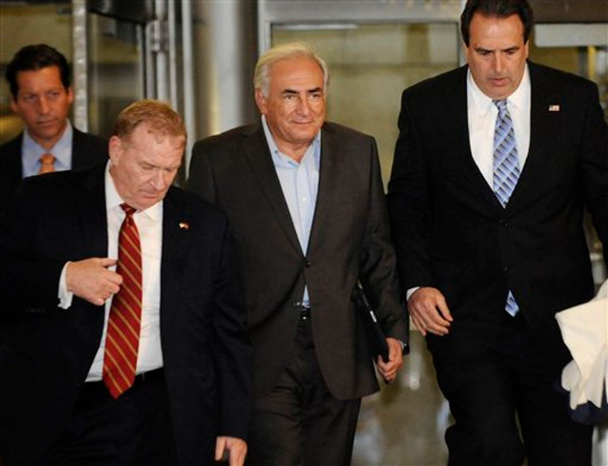 Dominique Strauss-Kahn, center, is led from 71 Broadway in Manhattan's financial district where the former International Monetary Fund leader was staying following his release on bail, Wednesday, May 25, 2011, in New York. (AP Photo/Louis Lanzano) (AP)