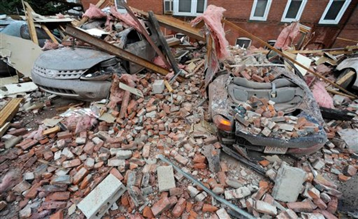 Bricks and debris that fell from a building lay on top of cars after a report of a tornado in Springfield, Mass., Wednesday, June 1, 2011. An apparent tornado struck downtown Springfield, one of Massachusetts' largest cities, scattering debris, toppling trees, and frightening workers and residents. (AP Photo/Jessica Hill) (AP)