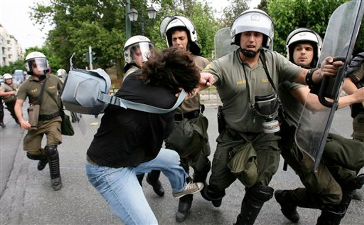 Police arrest a demonstrator trying to block the road to the Parliament during a rally against plans for new austerity measures, in central Athens, Wednesday, June 15, 2011. A 24-hour anti-austerity strike by Greece's largest labor unions crippled public services Wednesday, as the Socialist government was to begin a legislative battle to push through last-ditch cost-cutting reforms that will extend beyond its own term in office. (AP Photo) (AP)