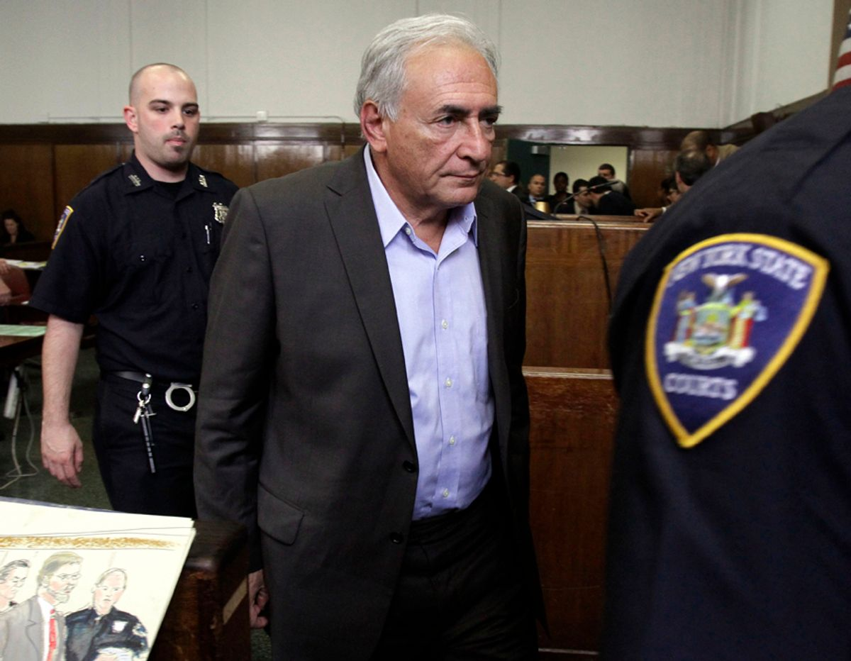 International Monetary Fund leader Dominique Strauss-Kahn leaves court court after his bail hearing in New York state Supreme Court,  Thursday, May 19, 2011.   A judge agreed to free Strauss-Kahn from a New York City jail on the condition that he post $1 million in bail and remain under house arrest, under the watch of armed guards, at a private apartment in Manhattan.  (AP Photo/Richard Drew, Pool) (Richard Drew)