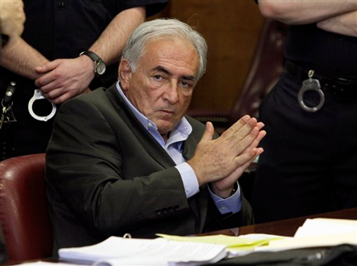 ** CORRECTS COURT DAY TO MONDAY AND ADDS DATE ** FILE - In this May 19, 2011 file photo, former International Monetary Fund leader Dominique Strauss-Kahn listens to proceedings in his case in New York state Supreme Court. Strauss-Kahn is due to answer the charges in court in New York Monday June 6, 2011 that he assaulted a hotel maid. (AP Photo/Richard Drew, File) (AP)