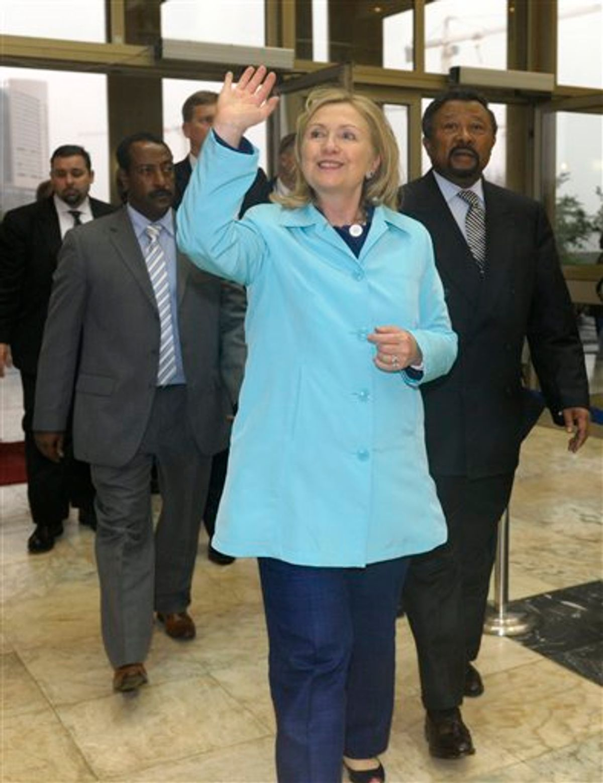 Secretary of State Hillary Rodham Clinton waves as she arrives and meets African Union Commission Chairperson Jean Ping, right, at the African Union headquarters in Addis Ababa, Ethiopia, Monday, June 13, 2011.  (AP Photo/Susan Walsh, POOL) (AP)