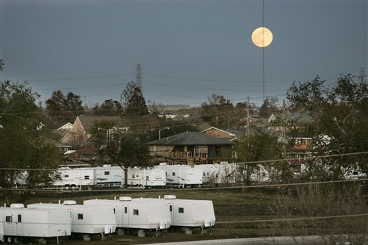 FILE -In this Dec. 15, 2005 file photo, the moon rises over FEMA trailers and damaged homes in St. Bernard Parish, La. Nearly six years have passed since Hurricane Katrina drowned this city in misery, but many residents haven't forgiven the Federal Emergency Management Agency for its sluggish response to the storm. Now another delayed reaction by FEMA _ a stop-and-start push to recoup millions of dollars in disaster aid _ is reminding storm victims why they often cursed the agency's name.( AP Photo/Gerald Herbert, File) (AP)