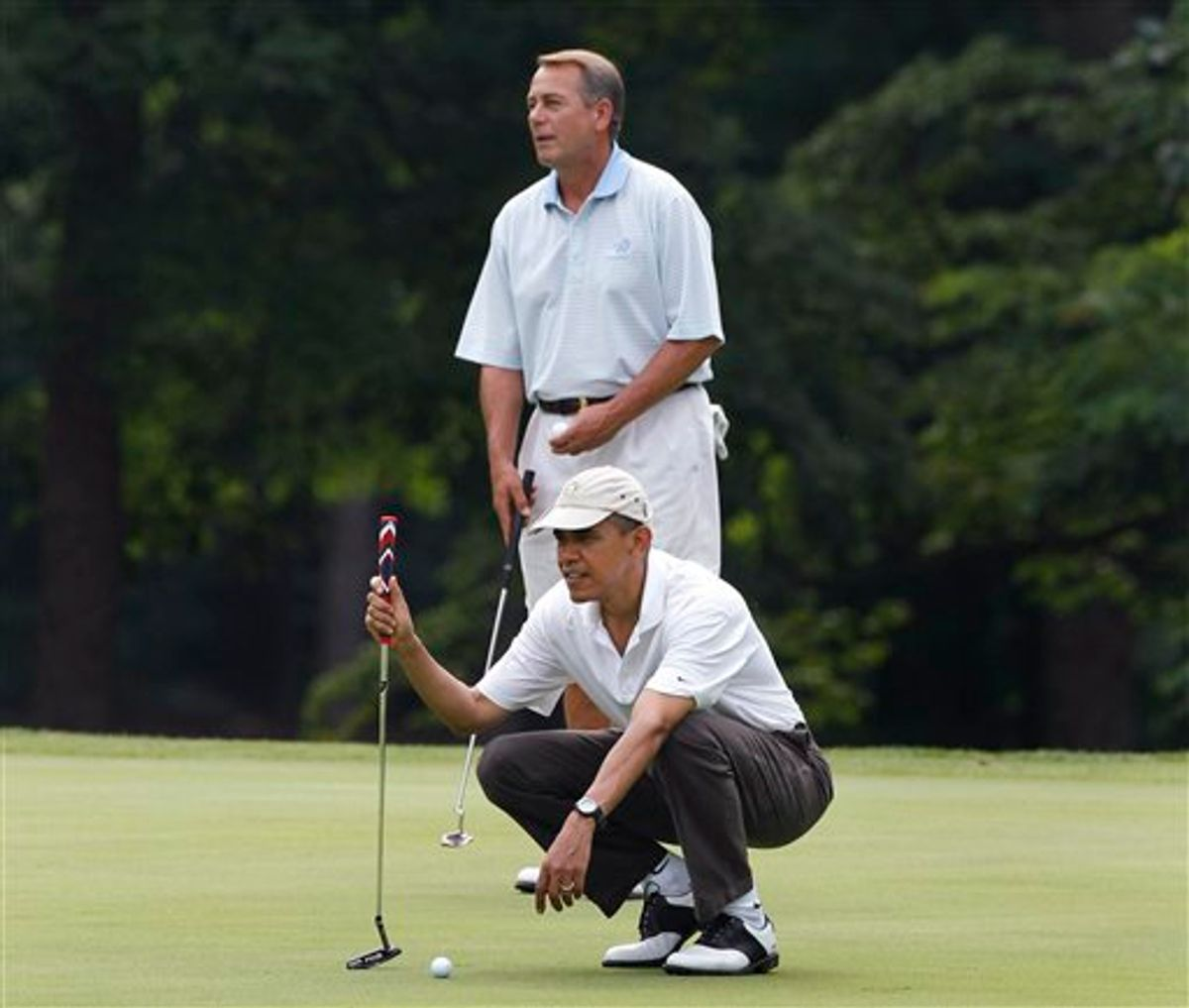 President Barack Obama and House Speaker John Boehner, R-Ohio, are on the first hole as they play golf at Andrews Air Force Base, Md.,  Saturday, June 18, 2011. (AP Photo/Charles Dharapak) (AP)
