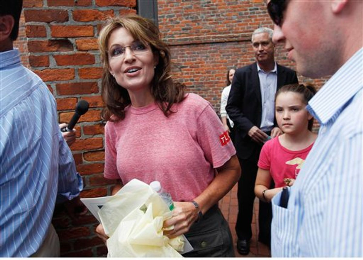 Former Alaska Gov. Sarah Palin, accompanied by her youngest daughter Piper, right, tours Boston's North End neighborhood, Thursday, June 2, 2011. (AP Photo/Steven Senne) (AP)