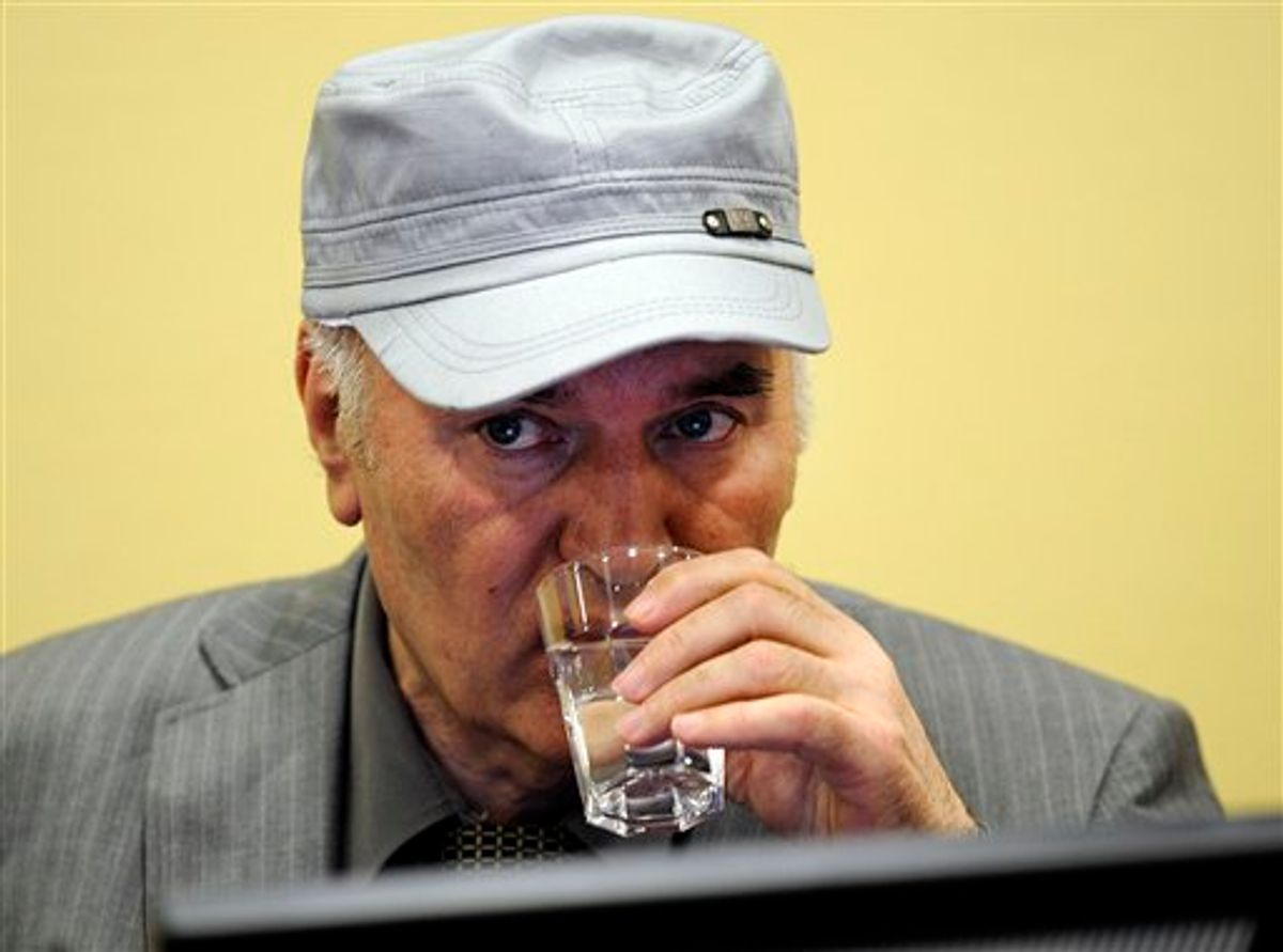 Former Bosnian Serb Gen. Ratko Mladic drinks water in the court room during his initial appearance at the U.N.'s Yugoslav war crimes tribunal in The Hague, Netherlands, Friday, June 3, 2011. Mladic's appearance Friday at the Yugoslav war crimes tribunal in The Hague is his first public appearance since he went into hiding nearly 16 years ago, when he was indicted for genocide and war crimes committed in the 1992-95 Bosnian war. (AP Photo/ Martin Meissner, Pool) (AP)