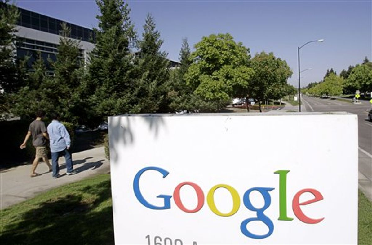 FILE - In this July 17, 2006 file photo, Google workers walk by a Google sign at company headquarters in Mountain View, Calif. Google says computer hackers in China broke into the Gmail accounts of several hundred people, including senior government officials in the U.S. and political activists. The attacks announced Wednesday, June 1, 2011 on Google's blog aren't believed to be tied to a more sophisticated assault originating from China in late 2009 and early last year. (AP Photo/Paul Sakuma, File) (AP)