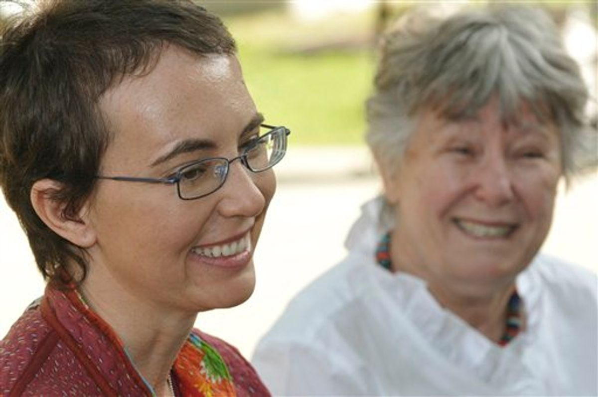 ADDS IDENTITY OF WOMAN AT RIGHT - This, most recent photo of Rep. Gabrielle Giffords since she was shot, was posted to her public Facebook page by her aides Sunday morning June 12, 2011.  The woman in the background is her mother Gloria Giffords. The photo was taken May 17, 2011 at TIRR Memorial Hermann Hospital, the day after the launch of Endeavour and the day before she had her cranioplasty.Giffords could be released from a rehabilitation hospital in Houston sometime this month, a top aide says, offering the latest indication that the Arizona congresswoman is making progress in recovering from a gunshot wound to the head. (AP Photo/Giffords Campaign - P.K. Weis) (AP)