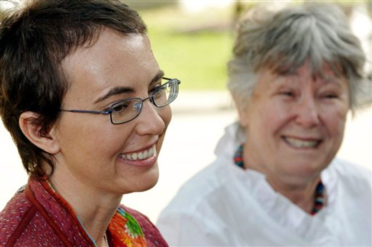 ADDS ADDITIONAL SOURCING INFORMATION - This most recent photo of U.S. Rep. Gabrielle Giffords since she was shot, was posted to her public Facebook page by her aides early Sunday, June 12, 2011.  The woman in the background is her mother Gloria Giffords. The photo was taken May 17, 2011 at TIRR Memorial Hermann Hospital in Houston, the day after the launch of space shuttle Endeavour and the day before she had her cranioplasty. Giffords could be released from a rehabilitation hospital in Houston sometime this month, a top aide says, offering the latest indication that the Arizona congresswoman is making progress in recovering from a gunshot wound to the head. (AP Photo/southwestphotobank.com, P.K. Weis) MANDATORY CREDIT  (AP)