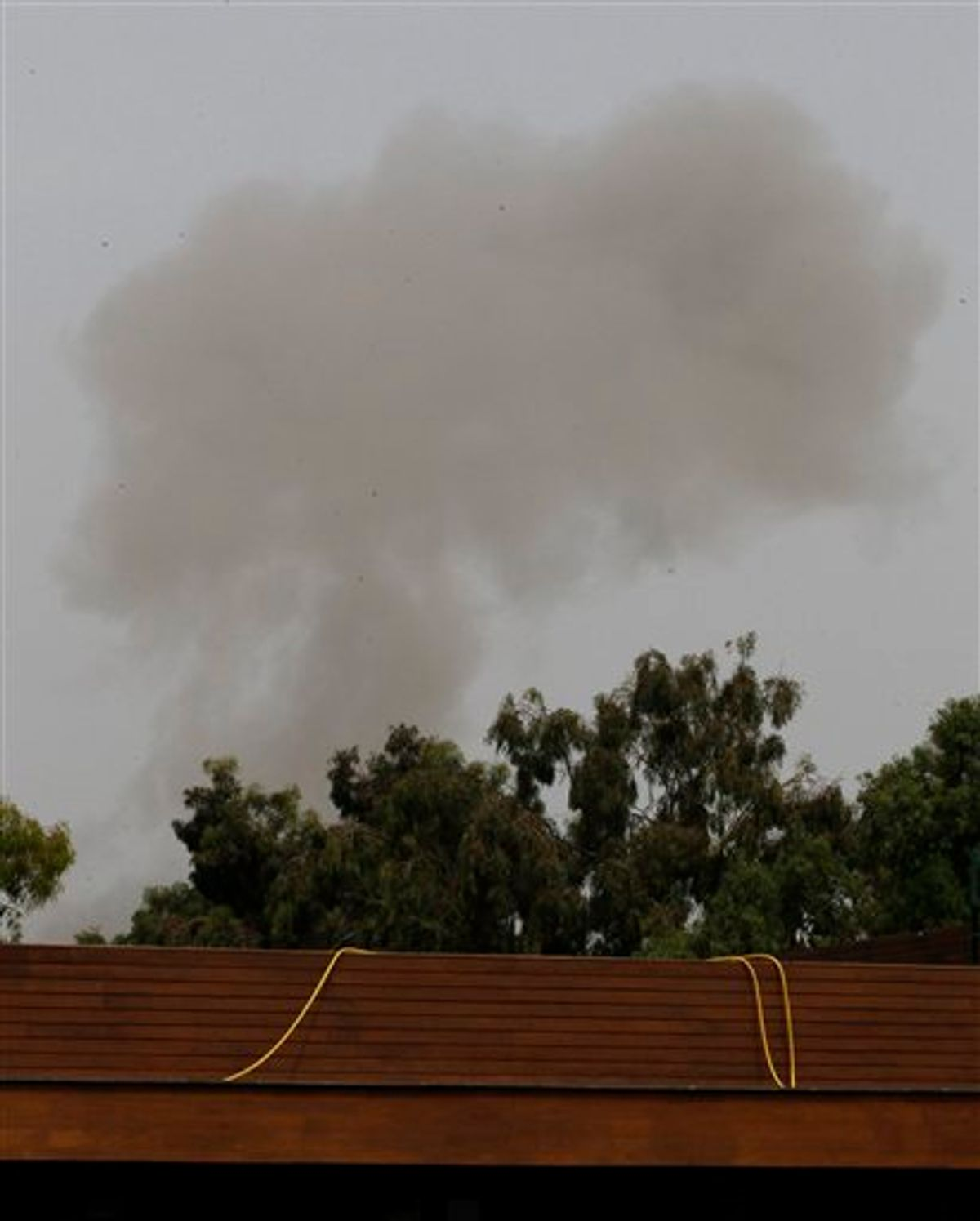 A smoke plume rises into the sky over Tripoli, Libya, on Tuesday, June 7, 2011 following an airstrike. Low-flying NATO military craft have struck seven times in loud, banging succession over the Libyan capital Tripoli. The strikes occurred Tuesday morning, marking an increase in NATO pressure on the regime of Moammar Gadhafi. (AP Photo/Ivan Sekretarev) (AP)