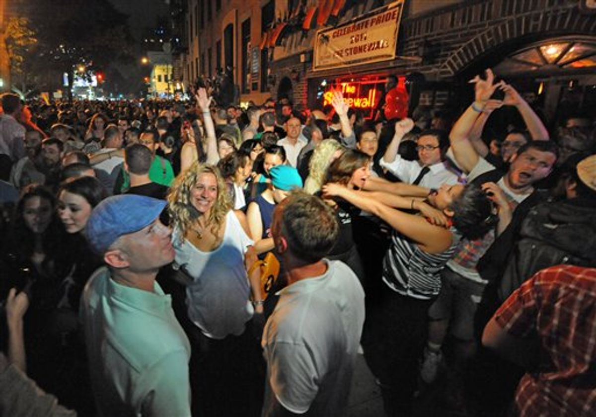 Revelers celebrate in front of the Stonewall Inn in Manhattan's west village following the passing of the same sex marriage bill by a vote of 33 to 29, Friday, June 24, 2011, in New York. Same-sex marriage is now legal in New York after Gov. Andrew Cuomo signed a bill that was narrowly passed by state lawmakers Friday, handing activists a breakthrough victory in the state where the gay rights movement was born. The gay rights movement is considered to have started with the Stonewall riots in New York City's Greenwich Village in 1969. (AP Photo/Louis Lanzano) (AP)