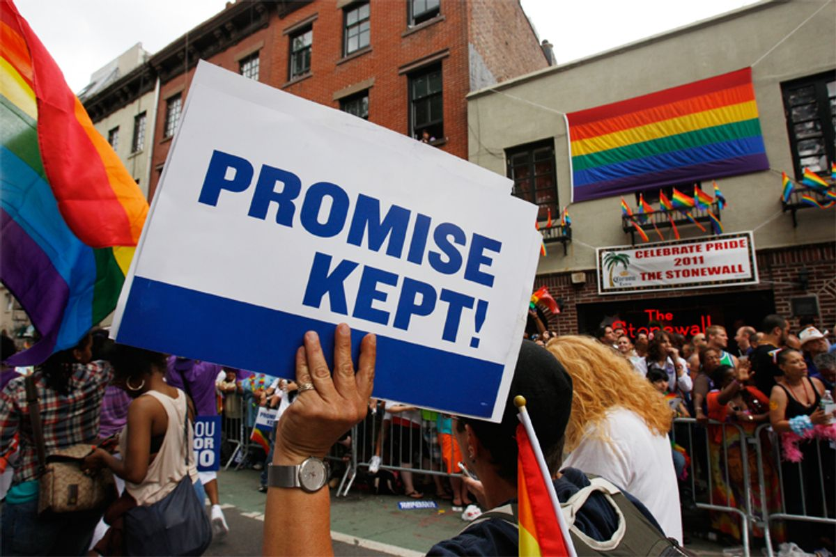 A participant in the Gay Pride Parade marches past the Stonewall Inn in New York on June 26.