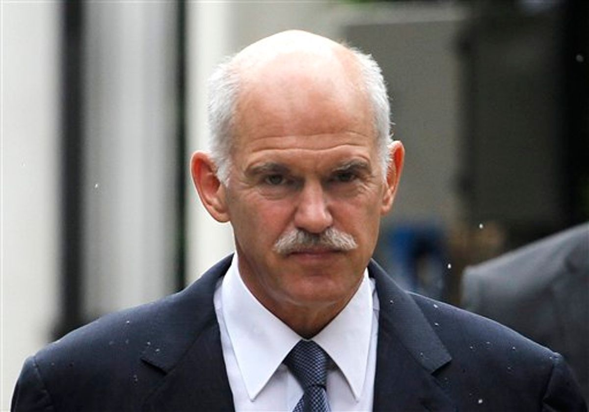 Greek Prime Minister George Papandreou, arrives the Presidential Palace before his meeting with the Greek President Karolos Papoulias, in central Athens, on Wednesday, June 15, 2011.Papandreou and conservative party leader Antonis Samaras discussed the creation of a power-sharing government to deal with the country's crippling debt crisis during a telephone conversation, an opposition party official told The Associated Press. The official spoke on condition of anonymity because the negotiations were still ongoing. The official said the conservatives' conditions for participating in a potential grand coalition were that Papandreou leaves his current position as prime minister, and the new government re-negotiate the bailout agreement. (AP Photo/Petros Giannakouris) (AP)