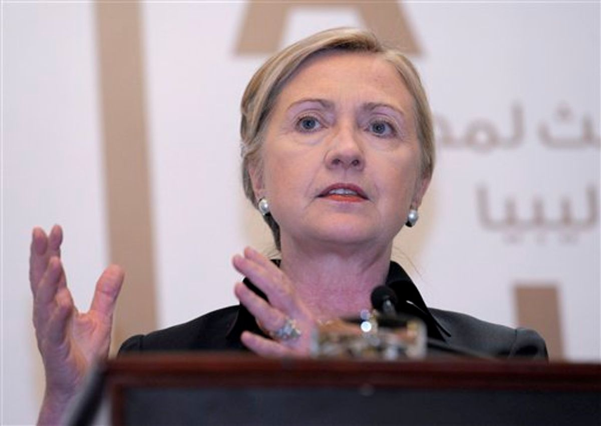 Secretary of State Hillary Rodham Clinton speaks during a news conference at the Emirates Palace Hotel in Abu Dhabi, United Arab Emirates, Thursday, June 9, 2011, following the Third Contact Group Meeting on Libya. (AP Photo/Susan Walsh, Pool) (AP)