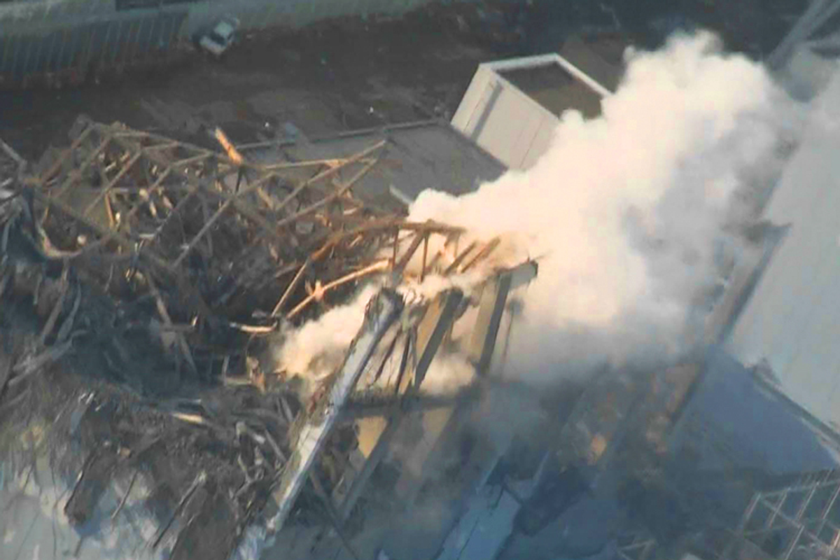 An aerial view shows steam rising from the No. 3 reactor at the Fukushima Daiichi nuclear power complex on March 16