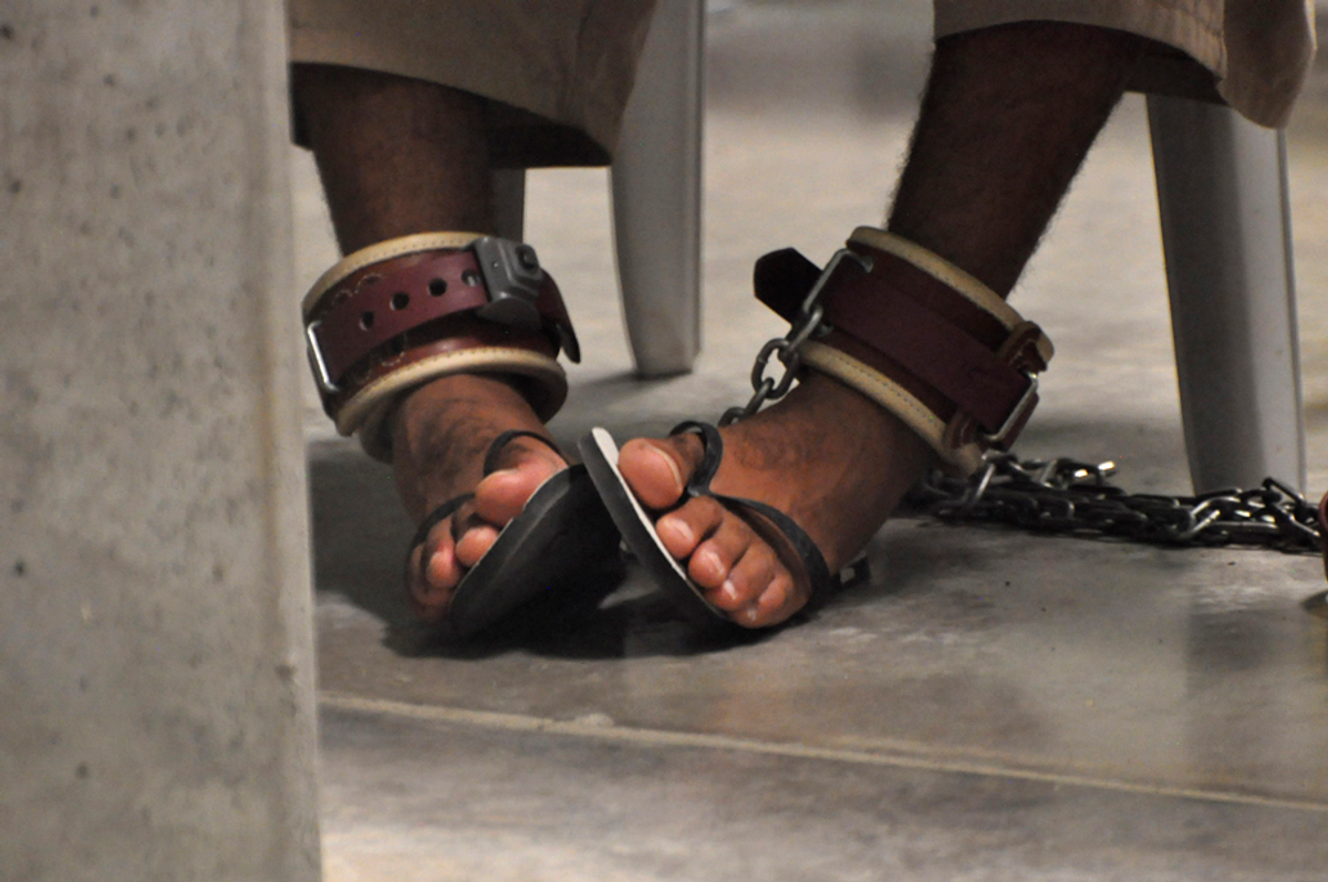 """A Guantanamo detainee's feet are shackled to the floor as he attends a """"Life Skills"""" class inside the Camp 6 high-security detention facility on Guantanamo Bay U.S. Naval Base in Cuba, Tuesday, April 27, 2010"""