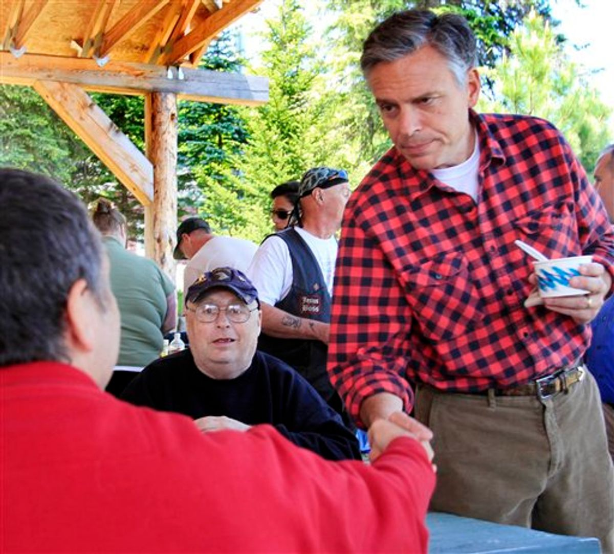 With his wife Mary Kaye at his side possible 2012 presidential hopeful, former Republican Gov. Jon Huntsman, Jr., of Utah shakes hands during a cultural festival at Heritage Park, Saturday, June 4, 2011 in Berlin, N.H. (AP Photo/Jim Cole) (AP)