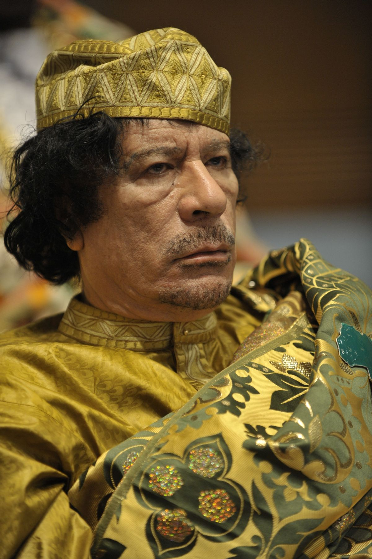 Muammar Qaddafi, the Libyan chief of state, attends the 12th African Union Summit in Addis Ababa, Ethiopia, Feb. 2, 2009. Qaddafi was elected chairman of the organization. (U.S. Navy photo by Mass Communication Specialist 2nd Class Jesse B. Awalt/Released)     (Cjtf-hoa/pao)