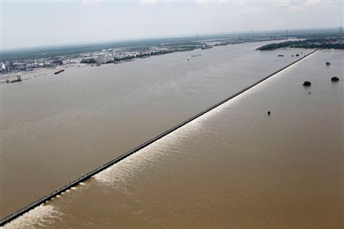 Water from the Mississippi River, left, is seen from the air as it is diverted through the floodgates of the Bonnet Carre Spillway towards Lake Pontchartrain (not pictured) in Norco, La., just upriver from New Orleans, Friday, June 3, 2011. (AP Photo/Gerald Herbert) (AP)