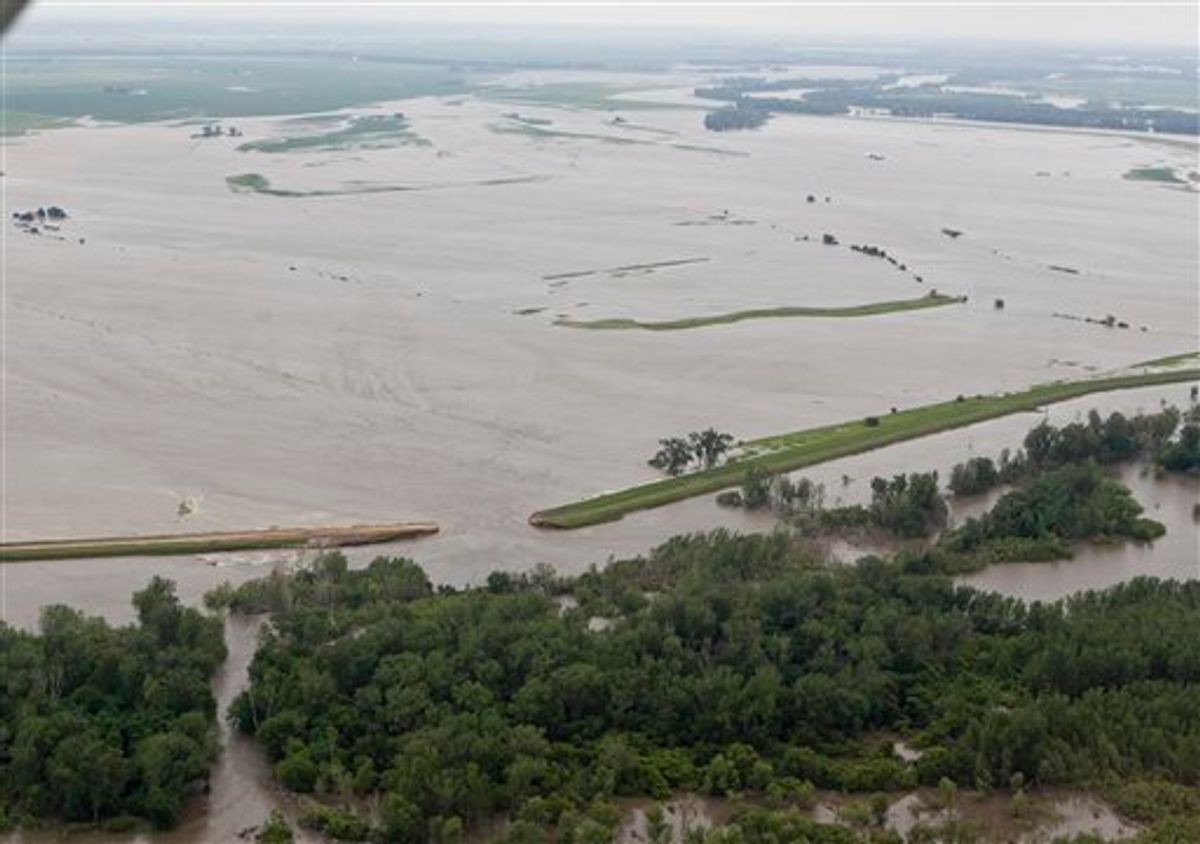 An aerial view of a ruptured levee near Hamburg, Iowa, Monday, June 13, 2011, which was letting in water from the Missouri river. The rising Missouri River has ruptured two levees in northwest Missouri, sending torrents of floodwaters over rural farmland toward the Iowa town of Hamburg and the Missouri resort town of Big Lake. (AP Photo/Nati Harnik) (AP)