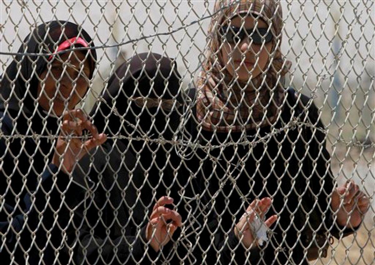 Palestinian women wait to cross to Egypt at the Rafah border crossing, southern Gaza Strip, Tuesday, June 21, 2011. (AP Photo /Hatem Moussa) (AP)