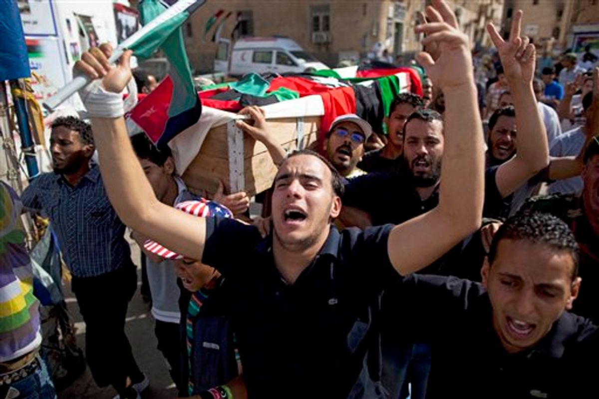 People carry the coffin of a rebel fighter killed on the front line against Moammar Gadhafi's forces during his burial next to the Transitional National Council headquarters in rebel stronghold Benghazi, Libya, Saturday, May 4, 2011. (AP Photo/Rodrigo Abd) (AP)