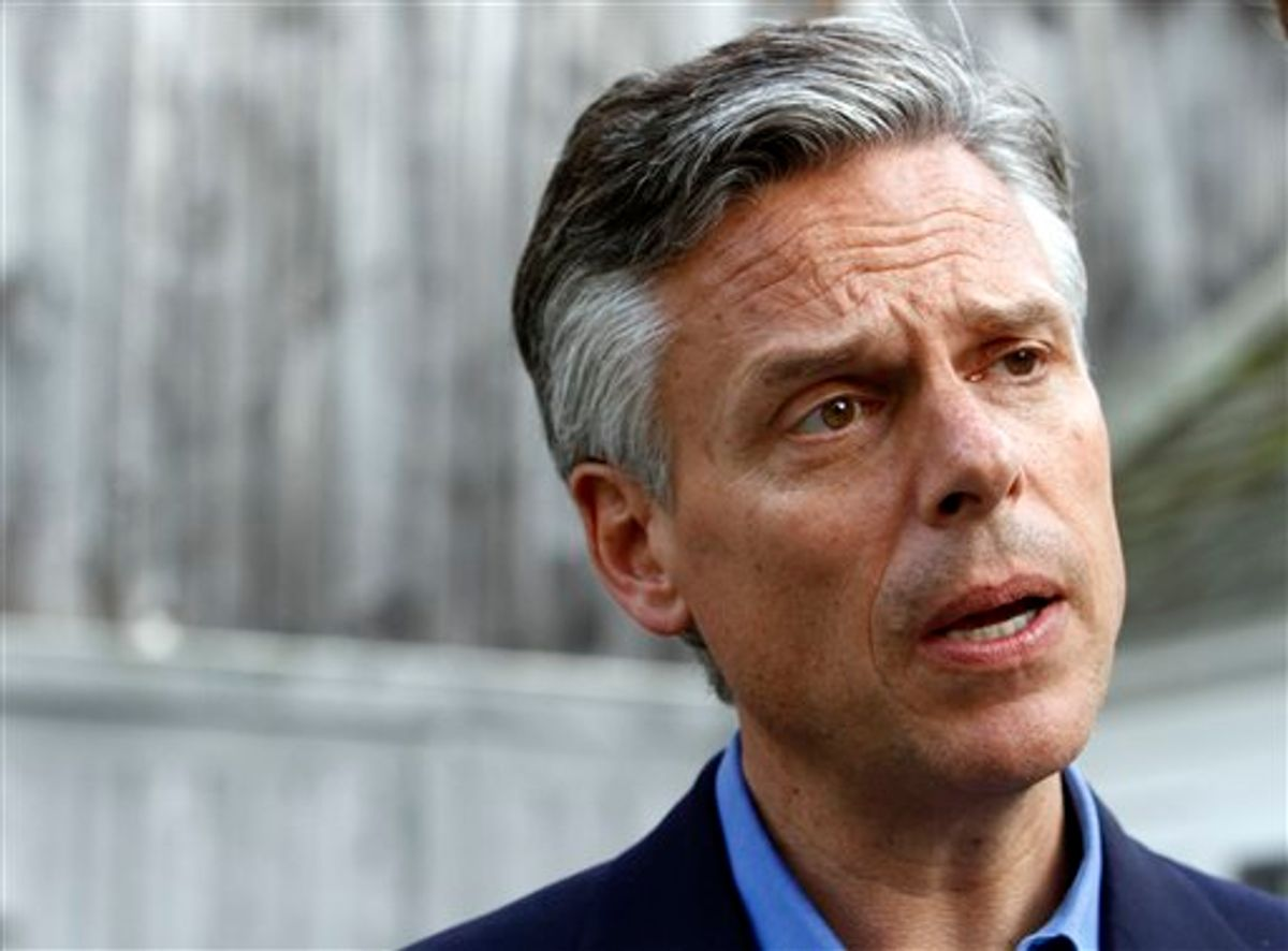 FILE - In this June 10, 2011 file photo, possible 2012 presidential hopeful, former Republican Gov. JonHuntsman, Jr., of Utah, speaks to a reporter at a gathering at the home of Nancy and Wally Stickney in Salem, N.H. (AP Photo/Elise Amendola) (AP)