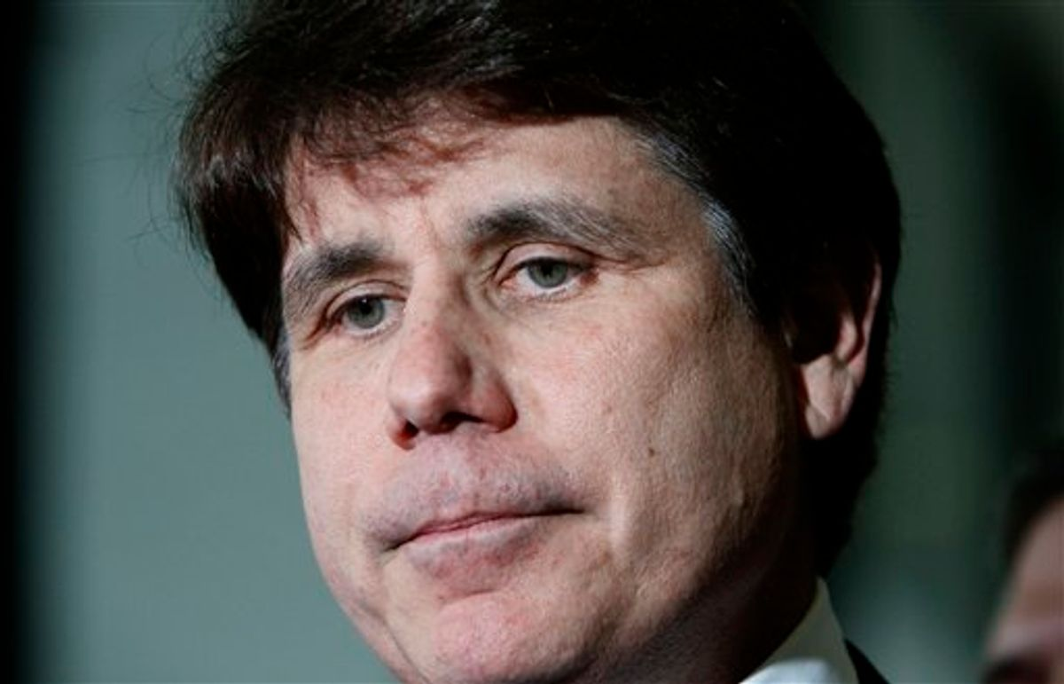 FILE - In this June 9, 2011 file photo, former Illinois Gov. Rod Blagojevich pauses as he talks with reporters at the Federal Court building after the judge handed the case to the jury in his corruption trial in Chicago. Jurors deliberating in Blagojevich's corruption trial told a judge on Monday, June 27, 2011, that they have reached a verdict on 18 of the 20 counts against him, and attorneys in the case have agreed that the verdict should be read. (AP Photo/Charles Rex Arbogast, File) (AP)