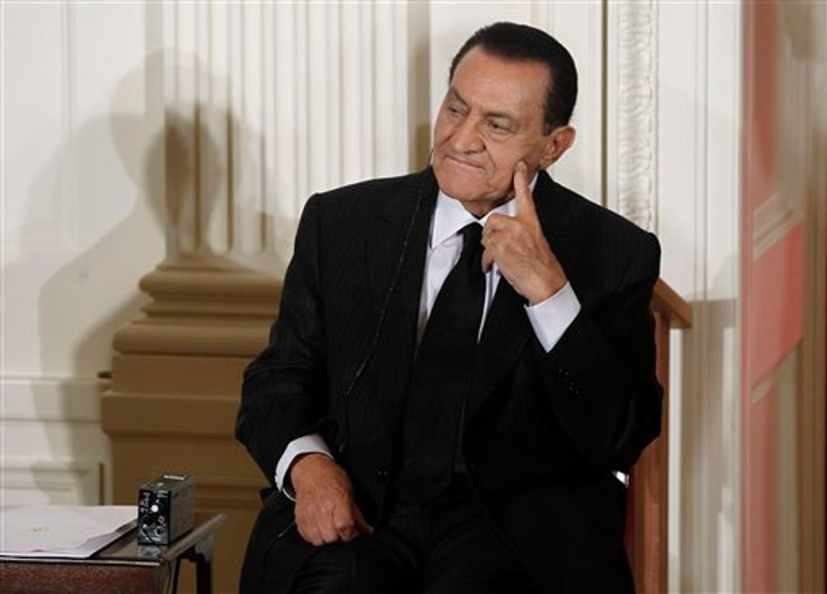 CORRECTS 2ND SENTENCE MUBARAK TO FACE TRIAL -- FILE - In this Wednesday, Sept. 1, 2010 file photo, Egypt's then President Hosni Mubarak listens as Israel's Prime Minister Benjamin Nethanyahu, unseen, speaks in the East Room of the White House in Washington. Hosni Mubarak will stand trial on charges of conspiring in the deadly shootings of protesters during the uprising that ousted him, the prosecutor-general said Tuesday, and in addition he and his two sons were charged with abusing power to amass wealth, enriching associates and accepting bribes - a major step in a country still rattled by protests and demands for justice.   (AP Photo/Charles Dharapak, File) (AP)