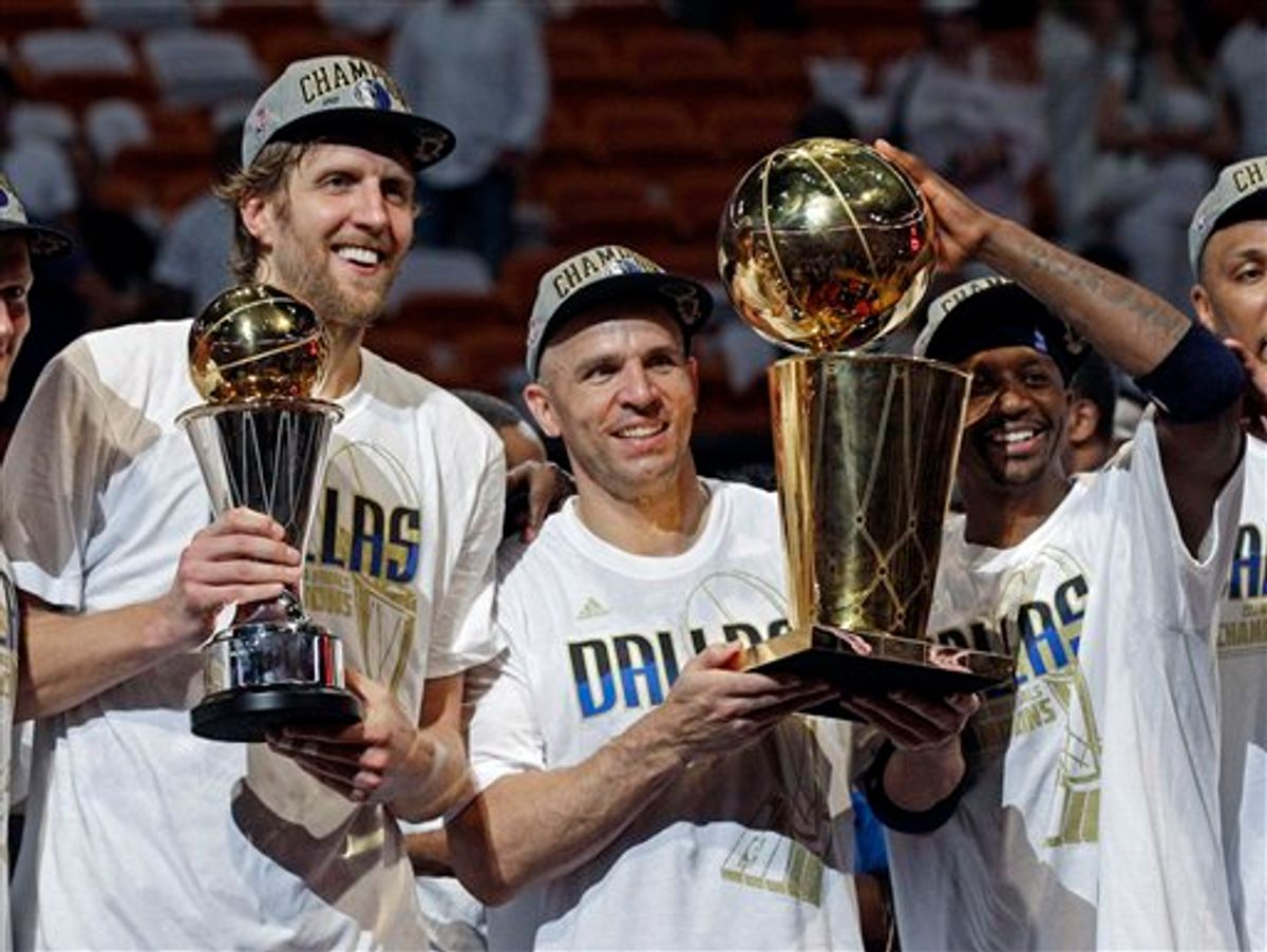 Dallas Mavericks' Dirk Nowitzki, Jason Kidd and Jason Terry hold up their trophies after Game 6 of the NBA Finals basketball game against the Miami Heat Sunday, June 12, 2011, in Miami. The Mavericks won 105-95 to win the series. (AP Photo/David J. Phillip)  (AP)