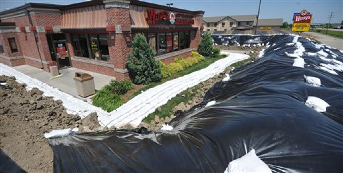 A Wendy's restaurant is surrounded by a temporary berm Monday June 6, 2011 in Hamburg, Iowa. The southwest Iowa town is under a mandatory evacuation order as the Missouri River continues to rise. (Photo/Dave Weaver) (AP)