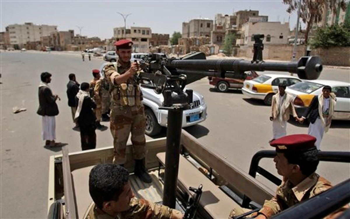 Yemeni army soldiers patrol in a vehicle an area in Sanaa, Yemen, Thursday, June 9, 2011. Government troops trying to recapture areas held by Islamic militants have killed 12 suspected al-Qaida members in the troubled southern province of Abyan, the Defense Ministry said Thursday. (AP Photo/Hani Mohammed) (AP)