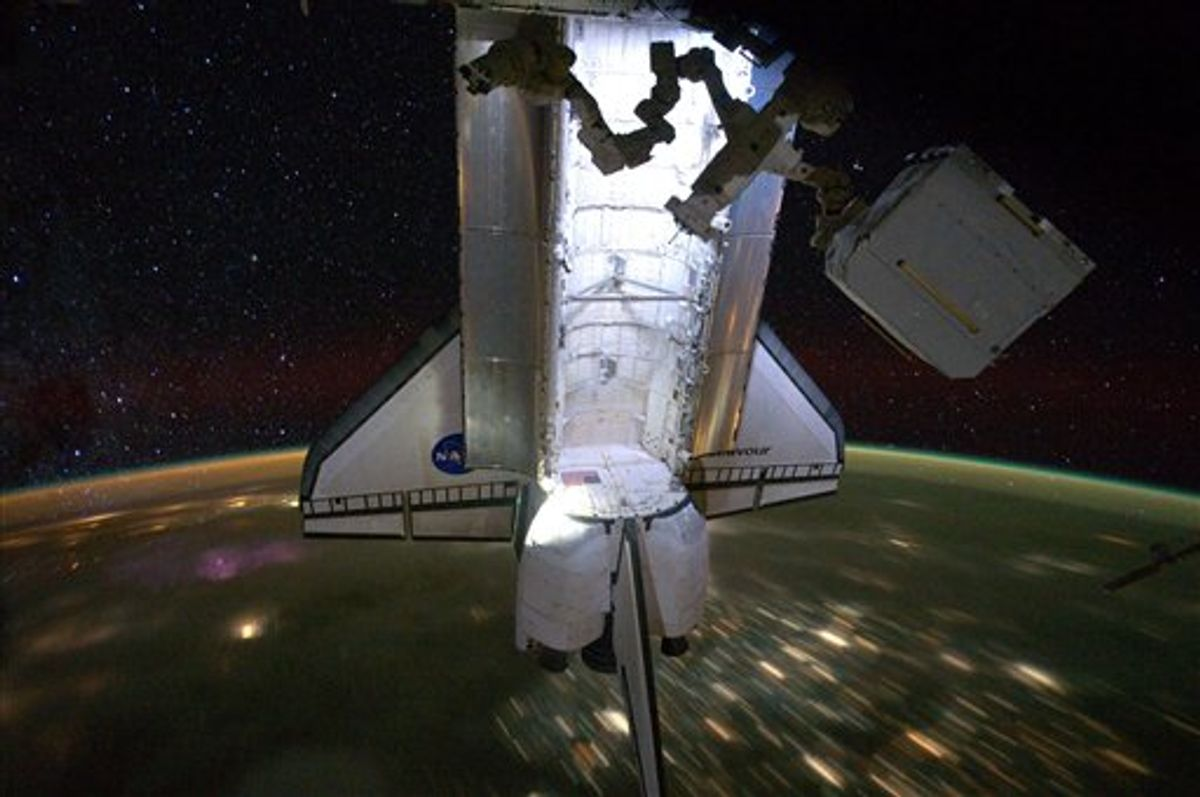 A photo released by Nasa shows the Endeavour with a backdrop of a night time view of the Earth and the starry sky, while docked at the International Space Station on Saturday May 28, 2011. The STS-134 astronauts left the station the next day on May 29, after delivering the Alpha Magnetic Spectrometer and performing four spacewalks during Endeavour's final mission.  (AP Photo/NASA)   (AP)