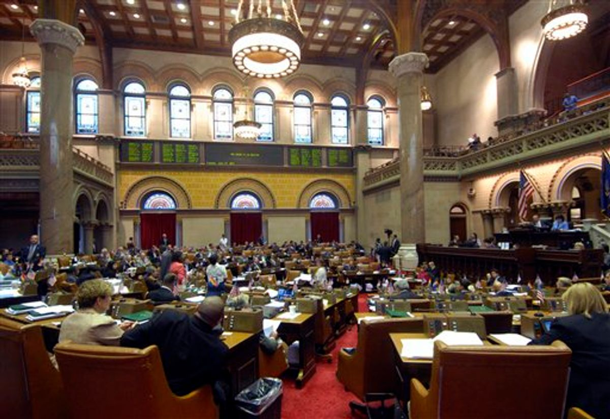 Members of the New York state Assembly hold a session at the Capitol in Albany, N.Y., Tuesday, June 14, 2011. Legalizing gay marriage in New York came within two votes of those needed for passage Monday as Gov. Andrew Cuomo rallied most Democrats and coaxed one Republican vote in the Senate. (AP Photo/Hans Pennink) (AP)