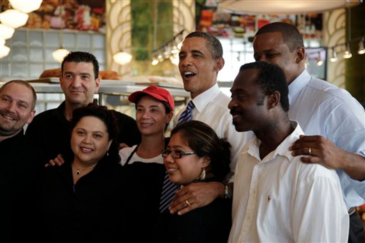 FILE - President Barack Obama, center, and Rep. Kendrick Meek, D-Fla., second from right, pose for photos at Jerry's Famous Deli after a fundraiser for Florida Democrats, in this Aug. 18, 2010 file photo taken in Miami Beach, Fla. President Barack Obama has problems in Florida that he didn't have when he won the pivotal swing state in 2008. The challenges show why Obama has been a frequent visitor to the Sunshine State. (AP Photo/Carolyn Kaster, FILE) (AP)