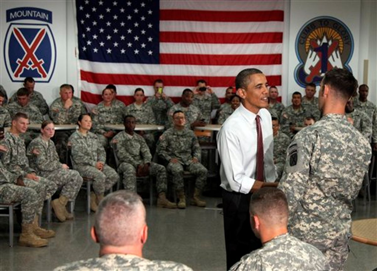President Barack Obama visits with soldiers from the 10th Mountain Division, many of whom have just returned from Afghanistan, Thursday, June 23, 2011, in Fort Drum, N.Y.  (AP Photo/Carolyn Kaster) (AP)