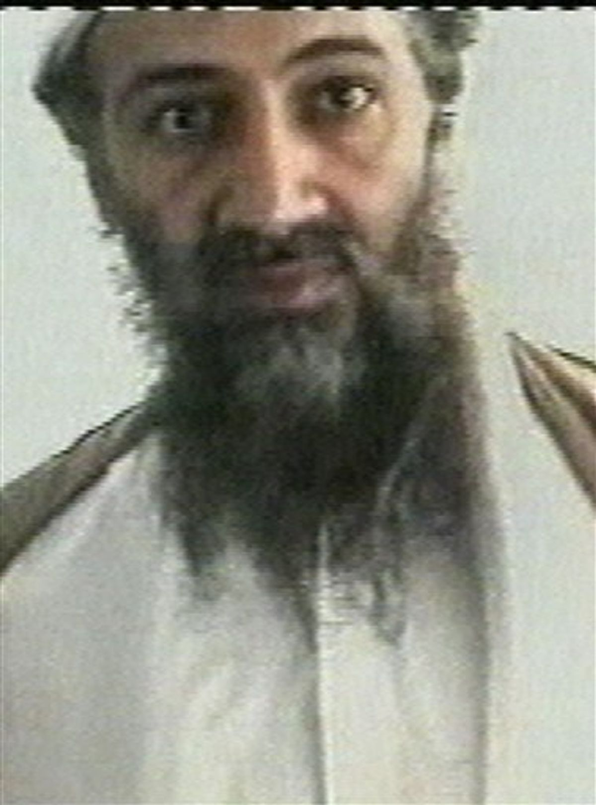 FILE - This undated image taken from video released by Al-Jazeera television on Oct. 5, 2001, shows Osama bin Laden at an undisclosed location. A cellphone of bin Laden's trusted courier recovered in the U.S. raid last month that killed both men in Pakistan contained contacts to a militant group that is a longtime asset of Pakistan's intelligence agency, The New York Times reported late Thursday. (AP Photo/Courtesy of Al-Jazeera via APTN, File) (AP)