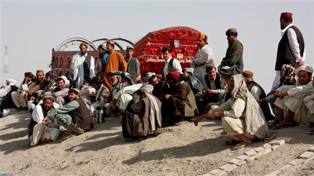 Pakistani truck drivers wait to cross the border to neighboring Afghanistan at the Pakistani border post in Chaman, Friday, June 17, 2011. About 300 Pakistani tribesmen briefly blocked NATO supplies and other traffic at a crossing along the border with Afghanistan on Friday to protest an alleged shooting incident, officials said. (AP Photo/Shah Khalid) (AP)