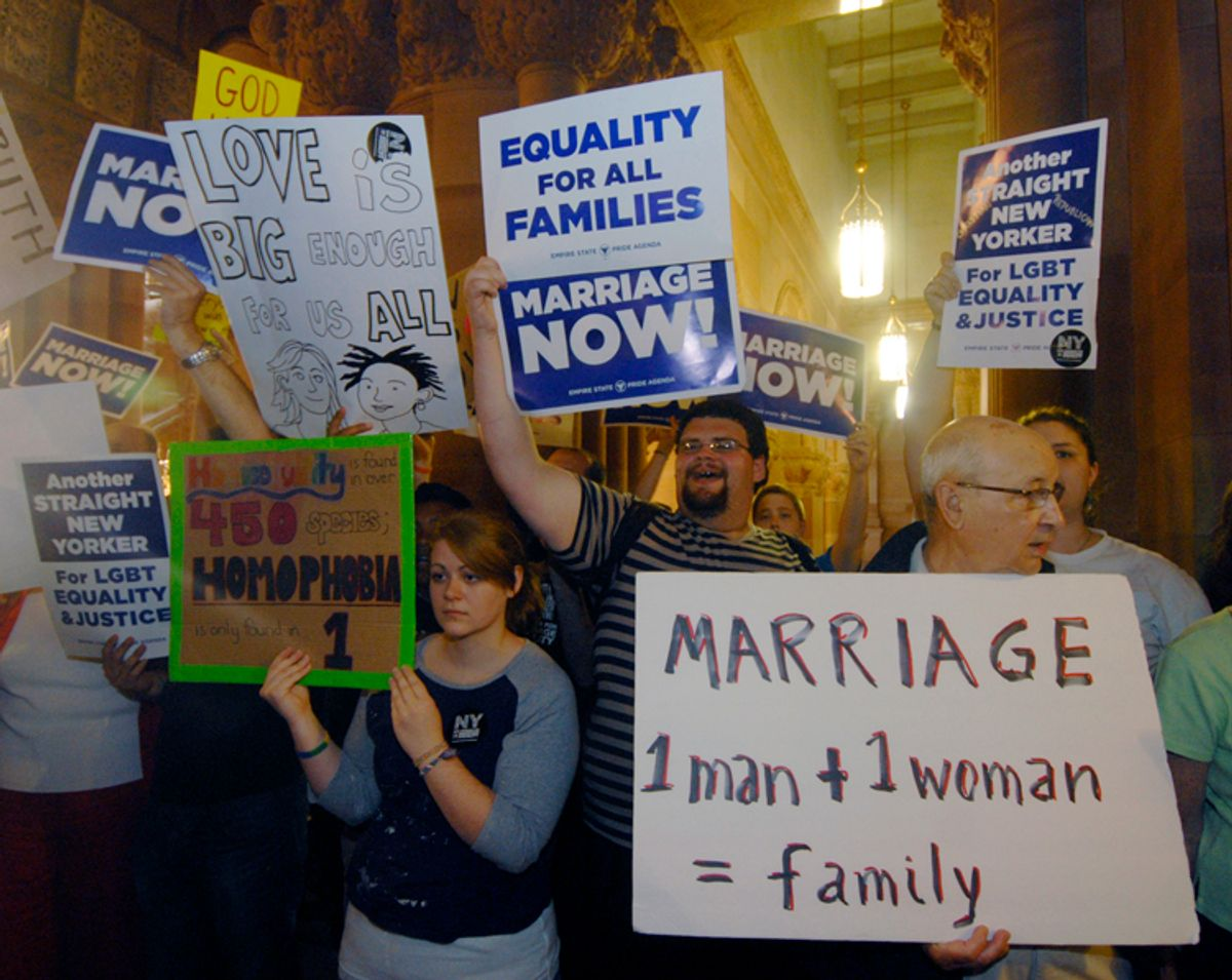 Gay marriage supporters and opponents rally in the hallways at the Capitol in Albany, N.Y., Friday, June 24, 2011.   Security was tight in the Capitol as opponents and supporters of same-sex marriage clogged the marble hallways after a week of rising tensions and great expectations. (AP Photo/Hans Pennink) (Hans Pennink)