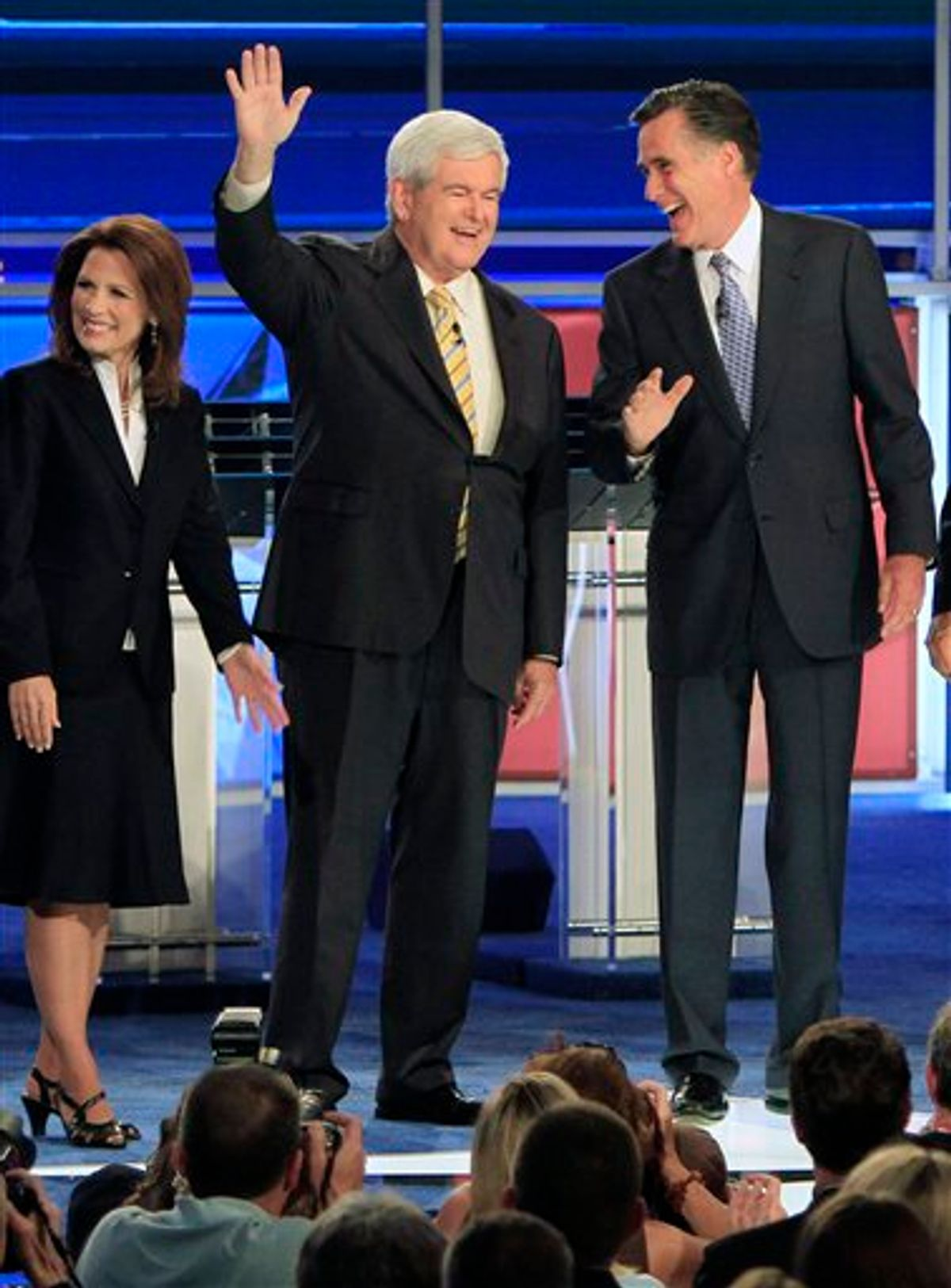 Former Massachusetts Gov. Mitt Romney, right, and former House Speaker Newt Gingrich share a laugh as they wave before the first New Hampshire Republican presidential debate at St. Anselm College in Manchester, N.H., Monday, June 13, 2011. Rep. Michele Bachmann, R-Minn., is at left. (AP Photo/Jim Cole)  (AP)