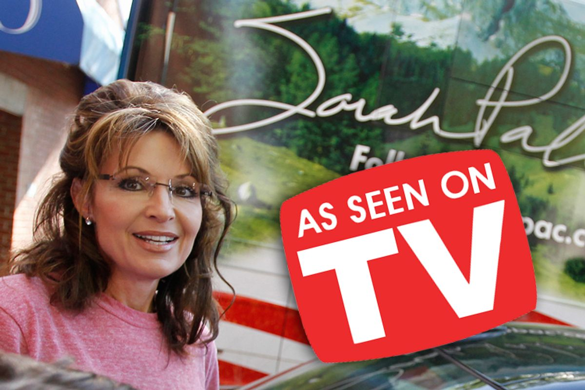 Sarah Palin in front of her bus