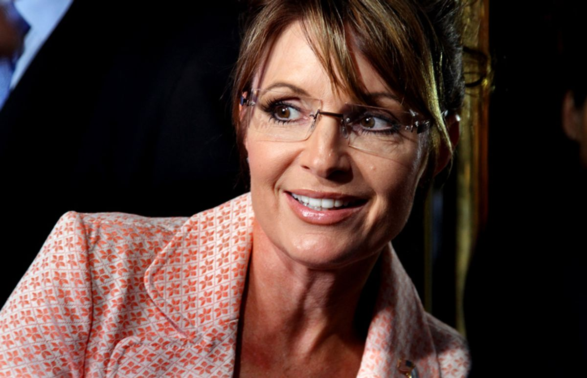 Former governor of Alaska Sarah Palin looks back at a crowd as she walks to the door of Trump Tower for a scheduled meeting with Donald Trump in New York Tuesday, May 31, 2011. (AP Photo/Craig Ruttle)  (Craig Ruttle)