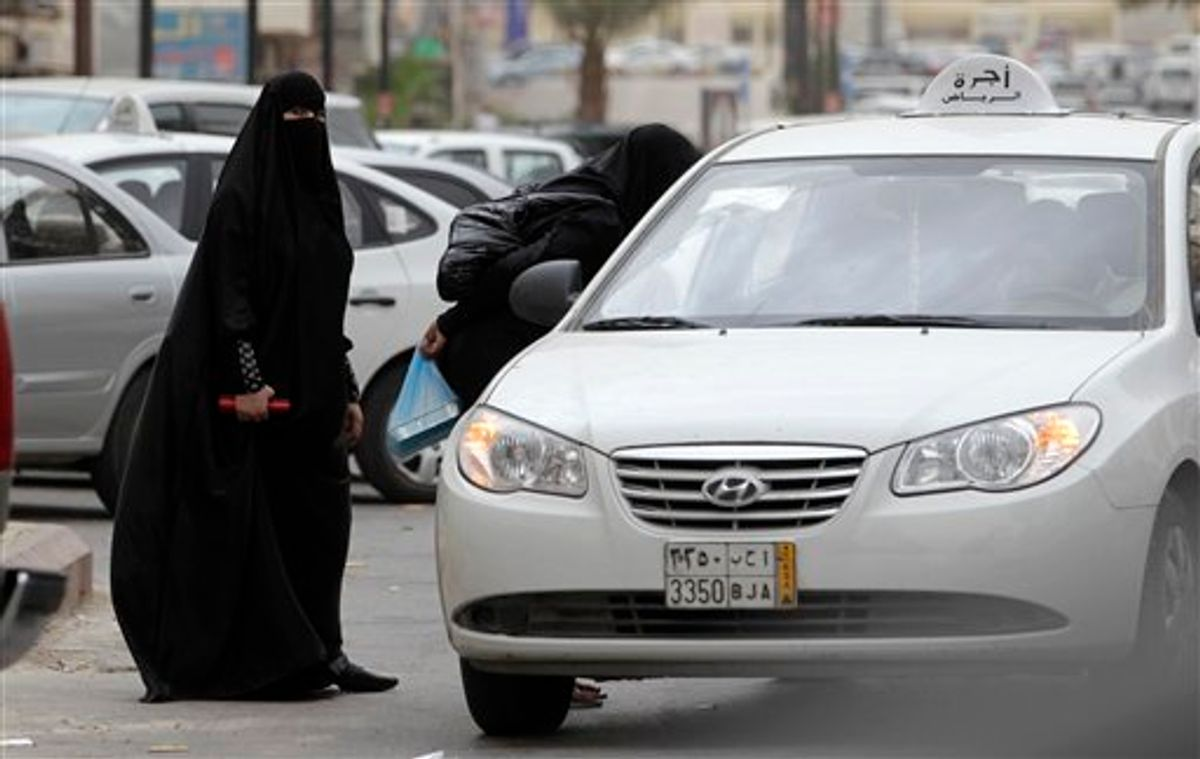 """Saudi women board a taxi in Riyadh, Saudi Arabia, Tuesday, May 24, 2011. A Saudi woman was arrested for a second time for driving her car in what women's activists said Monday was a move by the rulers of the ultraconservative kingdom to suppress an Internet campaign encouraging women to defy a ban on female driving. Manal al-Sherif and a group of other women started a Facebook page called """"Teach me how to drive so I can protect myself,"""" urging authorities to lift the ban and posted a video clip last week of al-Sherif behind the wheel in the eastern city of Khobar. The page was removed after more than 12,000 people indicated their support for its call for women drivers to take to the streets in a mass drive on June 17.  (AP Photo/Hassan Ammar) (AP)"""