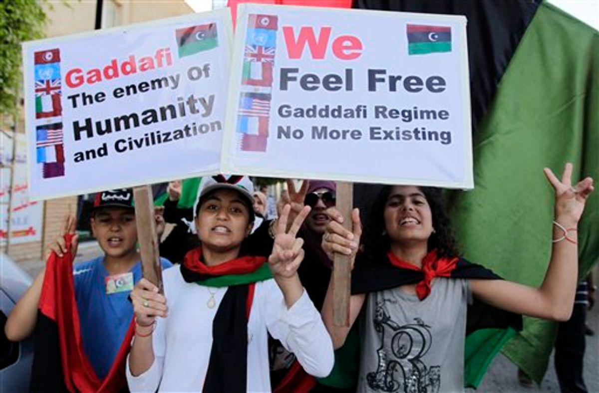 Libyan chant slogans against Moammar Gadhafi during a demonstration in the rebel-held capital Benghazi, Libya, Saturday, June 25, 2011. (AP Photo/Hassan Ammar) (AP)